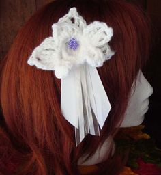 Womens Crocheted Beaded Ribboned White Orchid Hair Clip. $9.99, via Etsy.