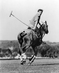 Spencer Tracy plays polo