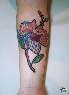 Illustrative magnolia tattoo on the inner right forearm. Tattoo Artist: Rit Kit