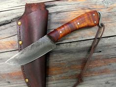 Hunting knife (used ONLY for processing game). The short blade makes it easier to skin animals. When piercing the skin of an animal, keep your index finger on the back of the blade, at the very tip, and use this finger to control the blade/avoid piercing the animal's gut (thus avoiding contamination of the meat).