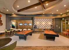Game lounge with gaming stations, billiards and iPod docking stations at AMLI RidgeGate, luxury apartments in Lone Tree.
