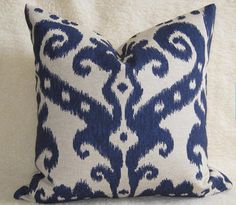 Decorative designer, traditional style printed Ikat pillow cover in Navy Design on an oatmeal/greige linen background. Zipper enclosure and overlocked stitched & serged sewn for a professional finish.