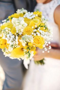 Yellow and white wedding bouquet - yellow roses, craspedia, calla lilies, stock, and baby's breath {Lena Mirisola Photography}
