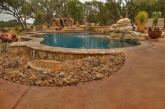 Pool area on the backyard of a home in dry country side.