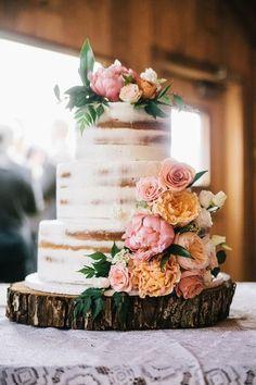 Rustic wedding cake idea - three-tier, semi-naked wedding cake with bright flower cake topper {McElligott Photography}