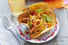 Chicken Tinga Tortilla Cups recipe -This quick riff on Mexican street food has lettuce, tomato, salsa and shredded chicken in crunchy tortilla cups for the kind of flavor kids eat up.