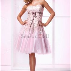Prom, homecoming, bridesmaid etc., dress. Sweet lookin silver dress. Blinged up all over with taffeta skirt under to make it flare! Just bought for a wedding but didn't fit right so never worn. Size 12-14. A must see!! Pics don't do it justice. the 2nd pic is what it looks like on but in pink. I had it custom made in the colors I wanted. Made in China Dresses