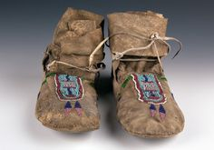 Northern Plains Beaded High Top Hide Moccasins, Crow, c. last quarter the buffalo hide hard sole with upper beadwork in red and pink white hearts, light blue,dark blue oval k Native American Legends, Native American Clothing, Native American Artifacts, Native American Beading, Crow Indians, Plains Indians, Red And Pink, Pink White, Cigar Store Indian