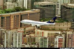 The approach to the old Kai Tak airport in Hong Kong. Mandarin B747SP.