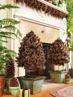 Pine cone Topiary and Garland. Love the pine cones UNDER the mantle, a whole new place to squeeze in decorations!