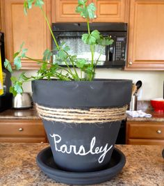 Spray paint pots with chalkboard pain, decorate with twine and plant herbs or flowers in them