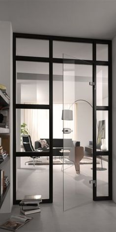 Beautiful door window wall partition with seamless glass door.    Favorite doors of www.andrearodman.com  A Vancouver based Interior Design Firm.