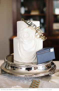 Two layered wedding cake with rose