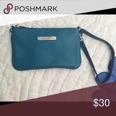 Michael Kors blue wristlet Small blue wristlet good for a night out for just a few things Michael Kors Accessories Key & Card Holders