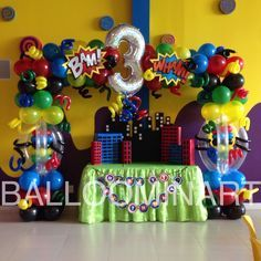 Super heroes balloon arch.