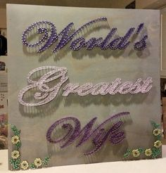 This Worlds Greatest Wife Sign would be a perfect birthday or Anniversary. Im sure it would make a unique gift for anyone. In the Note Section at checkout, please choose the colorations of string youd like, please write either the color or numbers: Worlds Color: Greatest Color: Wife Color: Flowers on Bottom Corners and Colors? Flowers on Top Corners and Colors? 1) Red 2) Currant (Burgundy) 3) Papaya (Orange) 4) Honey Bronze (Orange) 5) Gold Dust (Yellow) 6) Corn Silk (Light Yellow) 7)…