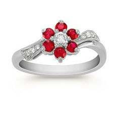 Round Ruby and Diamond Ring. resh and feminine, this charming fashion ring shows off a brilliant array of hand-matched rubies in a dainty floral pattern. Six round rubies, at appoximately .43 carat TW, are beautifully accented with seven round diamonds at approximately .15 carat TW. These gorgeous gems are set in quality 14 karat white gold with unique milgrain detailing. The total gem weight is approximately .58 carat. #ShaneCoLBD