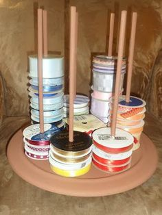 Ribbon Carousel made from a lazy susan and dowels. - Ribbon Carousel made from a lazy susan and dowels. Ribbon Carousel made from a lazy susan and dowels. Ribbon Organization, Ribbon Storage, Sewing Room Organization, Craft Room Storage, Craft Rooms, Shoe Storage, Storage Ideas, Storage Boxes, Organization Ideas