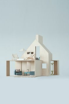 european wooden dollhouse by flora and henri
