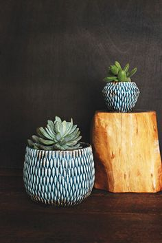 A blue ceramic planter with wonderful texture and glaze.