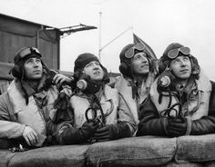 Czech-Slovak pilots from a Hurricane Fighter Squadron, watching some of their colleagues in flight, January 1940