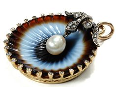 Vintage Banded Agete Pendent. In this particular piece, the designer has skillfully carved down through the various bands of color to mimic the color-shifts of a seashell, and then surrounded the stone with a frame of 17 rose-cut diamonds and a central natural pearl, all in 14k yellow gold. (Circa 1880.)