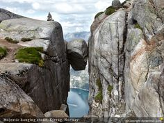 Put this amazing wallpaper of the Hanging Stone in Kjerag, Norway on your desktop.