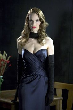 Hilary Swank looking spectacular in her navy satin dress and black opera gloves in a still from the film Black Dahlia
