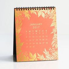 A modern and colorful 12-month calendar, gold foil in exclusive patterns pop on…