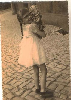 Antique photograph little girl wearing glasses holding her doll