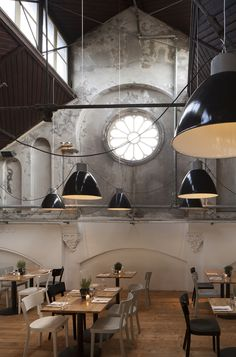 Mercat Amsterdam | This restaurant was built in an old church and the giant suspension lamps are incredible. | Find more inspiring lighting designs and solutions for your hospitality projects at Unique Blog http://delightfull.eu/blog/