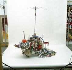 Bella Caracas is a display of found objects in the streets of Caracas, hanging from a supermarket cart. It is a cartography of domestics wastes.  Pepe López walks through the cities with a supermarket cart, recording his path with a video-camera while collecting trash, which later he classifies to use for his urban sculptures.