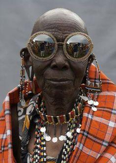 This is Rason, a Maasai Beader. She wears the Orbit Filigree sunglasses in Gold Glitter by Karen Walker.