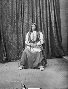 Portrait (Front) of Arapaho Man, Son of Chief Ouray?, in Partial Native Dress with Breastplate 1873 by William Henry Jackson (1843-1942)