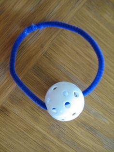 Make this simple model to demonstrate the differences between rotation and revolution. Thread a practice golf ball onto a pipe cleaner.  Twist the pipe cleaner closed, to make a loop. To show rotation: spin the ball. To show revolution: slide the ball around the pipe cleaner.