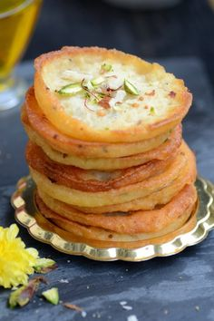 Mawa Malpua is a traditional Indian sweet from Rajasthan which is basically a fried pancake dunked in sugar syrup. It is served along with rabdi.