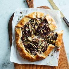 This best-ever galette gets flavor from delicious bitter greens and creamy ricotta cheese. Get the recipe at Food & Wine.