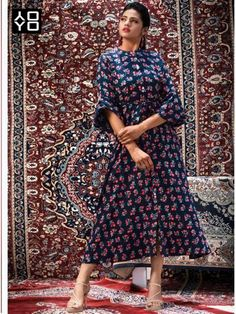 Add a small burst of color with your wardrobe with this blue fancy fabric party wear kurti. The print work a considerable characteristic of this dress. Diwali Dresses, Diwali Outfits, Bollywood Dress, Bollywood Fashion, Western Gown, Fancy Kurti, Kurti Collection, Printed Gowns, One Piece Outfit