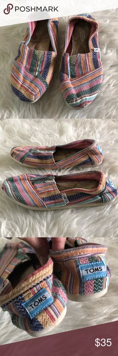 "Toms slip on multicolored shoes Toms classic slip on shoes. Pretty boho type print to add flavor to any outfit. Some ""puckering"" on soles from wash. So cute and comfortable! Size 7 Womens. Toms Shoes"