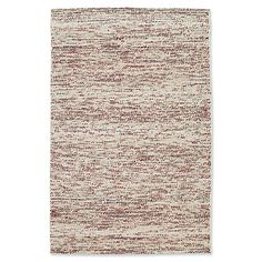 Featuring random flecks of color scattered on a soft cream background, the Cord Pixel Rug by Kaleen provides the appearance of texture in an easy-care woven rug. Handmade in India of 100% wool, it brings color and fun into any room.