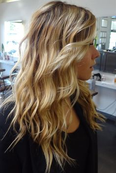 Beachy blonde highlights with long layers and waves for texture.