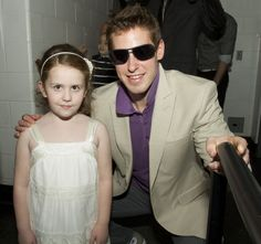 Behind-the-scenes:  John Moore and pediatric cancer hero Molly before they take the stage for the runway show