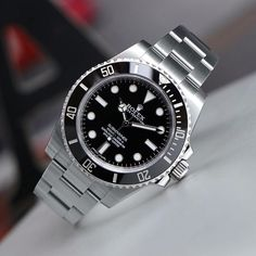 A classic. Black dial Rolex Submariner  no-date shot by @rolexdiver