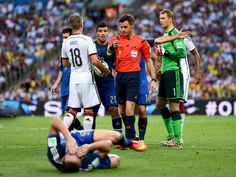Referee Nicola Rizzoli gives a free kick to Germany after a collision...