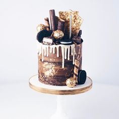Chocolate Freak-Cake! Chocolate cake with a white Belgian chocolate drip, gold painted Ferrero Rochers, chopped Chocolate bars (Toffee Crisp, Mars, Double Decker, Ripple, Twirl etc), butterscotch pieces, Oreo cookies and golden chocolate and hazelnut shards!