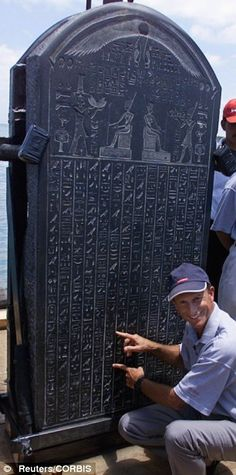 French Marine archaeologist Frank Goddio explains text on the stele of Heracleion
