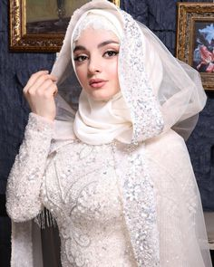 Image may contain: 1 person Muslim Wedding Gown, Muslimah Wedding Dress, Hijab Style Dress, Wedding Gowns, Bridal Hijab, Hijab Bride, Bridal Dresses, Wedding Hijab Styles, Celebrity Wedding Photos
