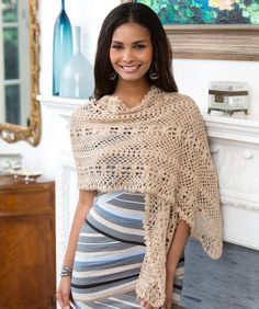 Wrap yourself in lovely lace with this flower patterned shawl. The shawl is crocheted lengthwise, creating long stripes.