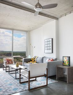 Urban Swank décor in a beautiful, floor-to-ceiling windowed space.