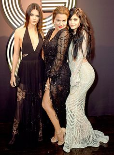 While older sister Kim Kardashian made a statement in a glitzy robe by Jean Paul Gaultier at the 57th Annual Grammy Awards, Kendall Jenner, Khloe Kardashian, and Kylie Jenner were spotted in flashy ensembles at the GQ and Giorgio Armani Grammys Afterparty.